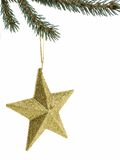 Christmas Star. Decoration hung from tree limb isolated on white Stock Photo