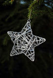 Christmas star. Christmas tree decoration with a dark background Royalty Free Stock Photo