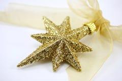 Christmas star. Golden Christmas star on withe Stock Image