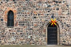 Christmas star above an old monastery door, Zinna, Germany royalty free stock photo