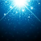 Christmas Star. Abstract Holiday Background With Christmas Star Light in Blue Stock Image