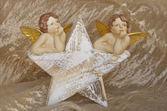 Christmas star and angels Royalty Free Stock Photo