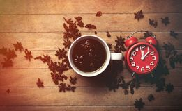 Christmas star anise tea and alarm clock. On wooden background Royalty Free Stock Photography