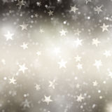 Christmas star background. Christmas background of bokeh lights and stars Royalty Free Stock Photos