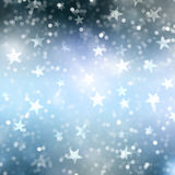 Christmas star background. Christmas background of bokeh lights and stars Royalty Free Stock Photo