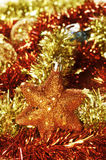 Christmas star, balls and tinsel Stock Images