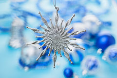 Christmas star bauble over blurred background Stock Images