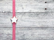 Christmas star biscuit and festive ribbon Stock Images