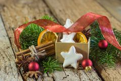 Christmas star biscuits, spices and ornaments on wooden table royalty free stock photo