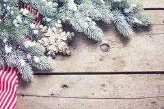 Christmas star and branches fur tree on  vintage wooden backgro Stock Images