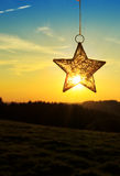 Christmas star and bright sun. Stock Image
