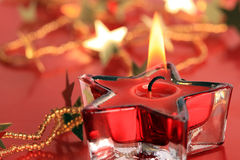 Christmas star candle Stock Photos