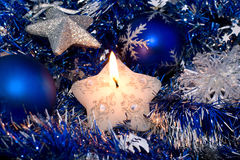 Christmas star candle and decorations. Christmas star candle and blue decorations royalty free stock photos
