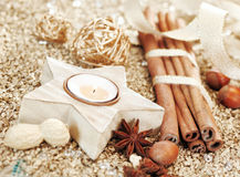 Christmas star candle and spices Royalty Free Stock Image