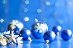 Christmas star closeup and baubles Royalty Free Stock Images