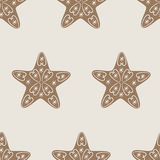 Christmas star cookie pattern. Christmas seamless pattern with star cookie decorated with vignettes and snowflakes on beige background. Ideal for holiday Royalty Free Stock Images