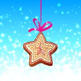Christmas star cookie with red ribbon on the blue Royalty Free Stock Photos