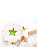 Christmas Star Cookie. Christmas star shaped linzer cookie decorated with powdered sugar and with green jam center stock photos