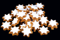 Christmas star cookies. A lot of beautiful Christmas cinnamon star cookies isolated on black background as a vertical image Royalty Free Stock Photo