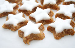 Christmas star cookies. With white toppings royalty free stock image