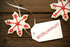 Christmas Star Cookies with Willkommen Label Stock Images