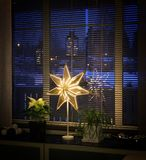 Christmas star decor by window. Decoration Christmas star lamp nearby window, winter afternoon blue moment royalty free stock photo