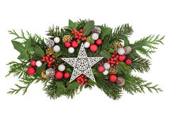 Christmas Star Decoration and Flora Stock Photography