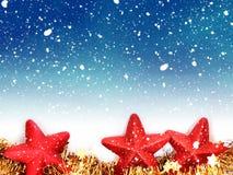 Christmas star decorations and snowfall stock photos