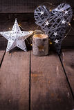 Christmas star, decorative heart, candleholder and fairy light. On aged wooden background. Decorative christmas composition. Place for text royalty free stock photos