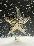 Christmas star with falling snow Stock Photo