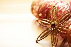 Christmas star and gift ribbon on golden Royalty Free Stock Photo