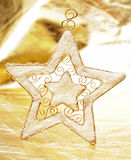 Christmas star on gold Stock Photos