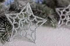 Christmas star. Christmas green twig in corner Royalty Free Stock Image