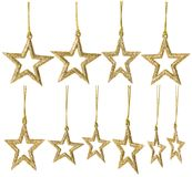 Christmas Star Hanging Decoration, New Year Sparkles Stars Set. Golden Toys Isolated over White Royalty Free Stock Image