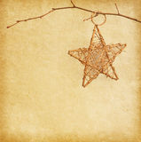 Christmas star hanging  over  old old paper Royalty Free Stock Photography