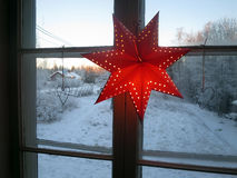 Christmas star. A Christmas star hangs in the window Royalty Free Stock Images