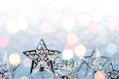 Christmas star holiday lights decoration on silver background Royalty Free Stock Photo