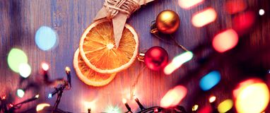 Christmas star and illumination decorations on wooden background. Copy space for lettering top view stock photo