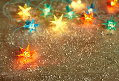 Christmas star lights frame on wooden background with copy space stock photos