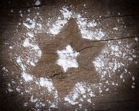 Christmas star made of sugar dust Royalty Free Stock Photography