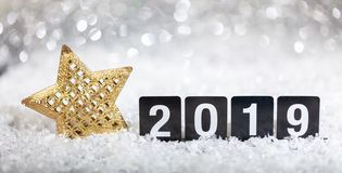Christmas star and new year 2019, on snow, abstract bokeh lights background. Copy space stock photo