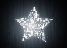 Christmas Star on Oak Wood. A christmas star made up of christmas elements on a oak wood background Royalty Free Stock Photo