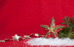 Christmas star orament on red background Royalty Free Stock Photography