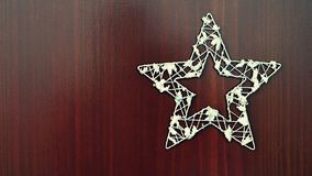 Christmas star ornament on a wooden background. Beautiful concept for Christmas time and winter royalty free stock photo