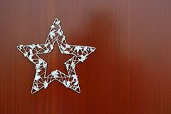 Christmas star ornament on a wooden background. Beautiful concept for Christmas time and winter stock images