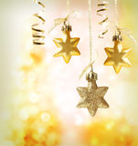 Christmas star ornaments. Over yellow orange lights background Stock Images