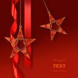 Christmas star ornaments against red background Stock Photos