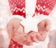 Christmas star on palms Stock Photo