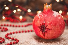 Christmas star in pomegranate stock photography