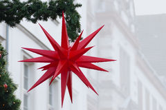 Christmas star  with raindrops, street decoration, copy space Stock Photos